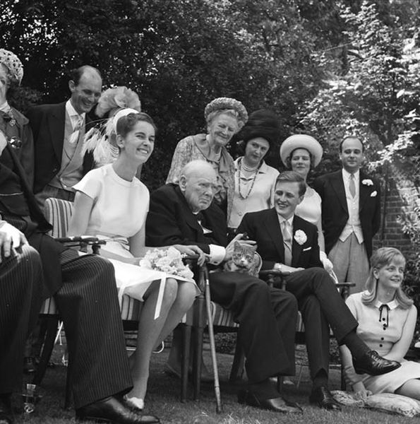 Churchill and Jock at the wedding of Churchill's grandson and Minnie d'Erlanger