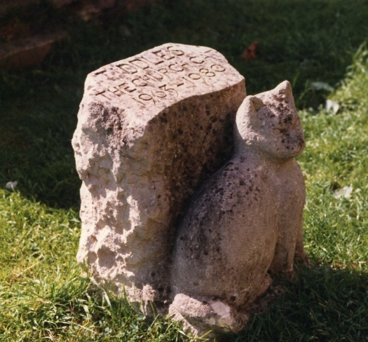 Tiddles commemorative stone in St Mary's Churchyard, Fairford, Gloucestershire.