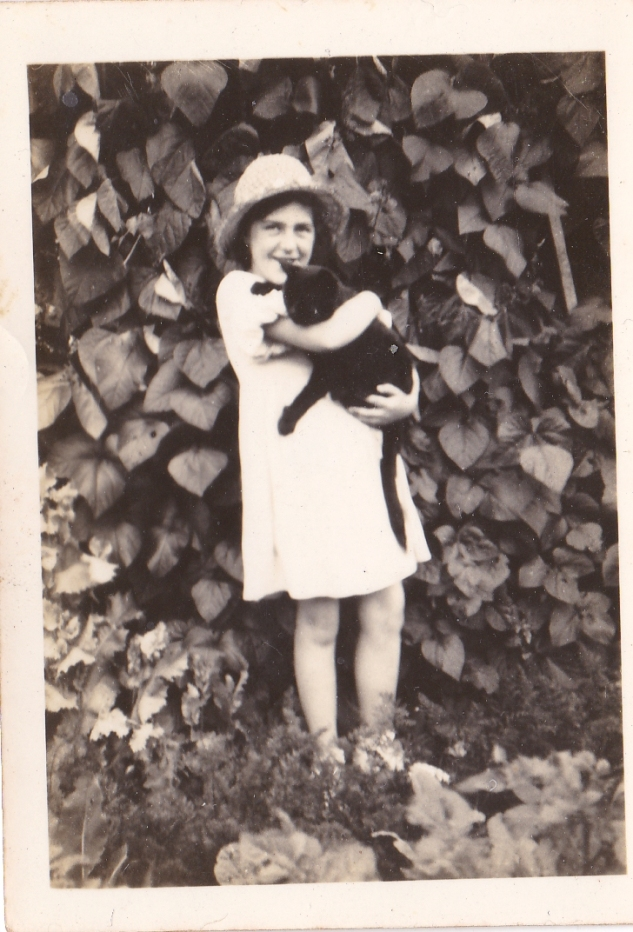 My mother with Blackjack in the garden at Macnaghten road, Bitterne, Southampton (1932).